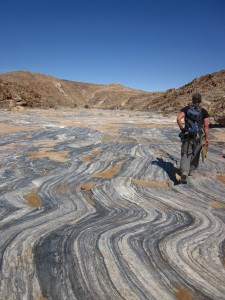 Ben Melosh, a graduate student working with Rowe, walks along the Pofadder Shear Zone in southern Namibia home to 1.1 billion-year-old afossilized earthquakes. (Louis Smit)