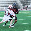 Jake Gutman of McGill Redmen lacrosse makes a play
