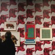 Patrons observe walls of Warhol's work. (LA Benoit / McGill Tribune)