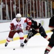 Dominic Poulin skates past a Carleton defender. (Lauren Benson-Armer / McGill Tribune)